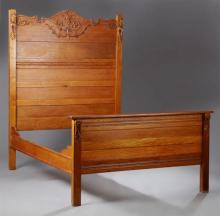 American Eastlake Carved Oak Highback Bed, c. 1900, the tall arched headboard with applied decoration to a footboard with applied de...