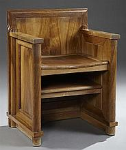 Unusual Louis Philippe Carved Walnut Pulpit Armchair, c. 1850, with a carved seat over a book shelf, the whole on integral cylindric...