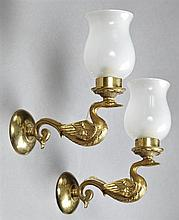 Pair of Empire Style Bronze Single Sconces, 20th c., of swan form, with frosted glass shades, H.- 8 1/2 in., W.- 2 1/2 in., D.- 7 1/...