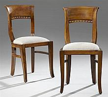 Pair of Carved Mahogany Biedermeier Style Side Chairs, 20th c., with curved pierced backs to slip seats, on saber legs joined by str...