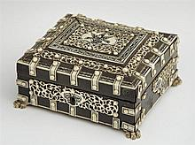 Diminutive Indian Bone and Ivory Dresser Box, early 20th c., with ivory strapping and buttons, the whole on bone paw feet, the lid,...