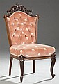 American Victorian Carved Walnut Upholstered Parlor Chair, 19th c., probably N.Y., with a pierced leaf and scroll carved crest over...