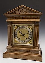 English Carved Oak Mantel Clock, early 20th c., of peaked form, with architectural decoration, time and strike, the brass face with...