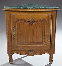French Provincial Louis XV Style Carved Oak Marble Top Corner Cupboard, 20th c., the highly figured verde antico triangular marble o...