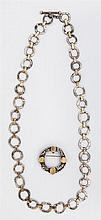 Anne Pratt Sterling and 18K Yellow Gold Link Necklace, consisting of hammered sterling circles joined by rectangular gold bands, tog...