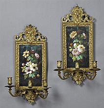 Pair of Bronze and Porcelain Three Light Sconces, early 20th c., the top and bottom with Bacchus masque surmounts around a hand pain...