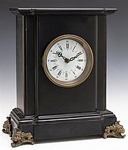 Black Slate Mantel Clock, 19th c., on gilt lion's head feet, now with a quartz movement, H.- 12 1/4 in., W.- 11 in., D.- 5 5/8 in.