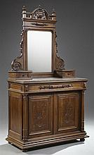French Henri II Style Carved Walnut Dresser, 19th c., the broken arch pediment flanked by turned finials above an arched wide bevele...