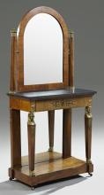 French Empire Carved Mahogany Marble Top Dressing Table, 19th c., the arched mirror within ormolu mounted supports, on a base with a...