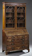 English Georgian Style Carved Mahogany Slant Front Secretary Bookcase, 19th c., the stepped ogee crown over double Gothic mullioned...