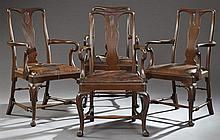 Set of Four Edwardian Style Carved Mahogany Queen Anne Armchairs, early 20th c., the pierced fiddle backs over trapezoidal slip seat...