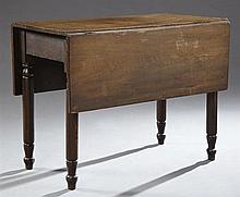 American Carved Birch Drop Leaf Dining Table, 19th c., the rectangular top over a wide skirt on ring turned tapered legs to tapered...