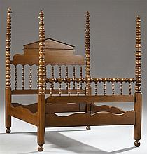 American Victorian Carved Oak Four Poster Double Spool Bed, late 19th c., the serpentine pointed spindled headboard supported by wel...
