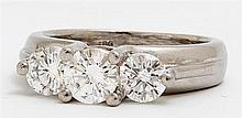 Lady's Platinum Dinner Ring, mid 20th c., the top mounted with three round diamonds, total diamond wt.- approx 1 ct., size 3 1/2, Wt..