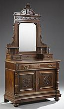 French Henri II Style Carved Walnut Marble Top Dresser, 19th c., the beribboned arched crest monogrammed