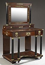 French Empire Style Ormolu Mounted Mahogany Dressing Table, c. 1900, the framed mirror on ebonized columnar supports over three glov...