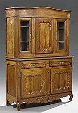 French Louis Philippe Inlaid Cherry Buffet a Deux Corps, 19th c., the arched crown above a central paneled cupboard door flanked by...