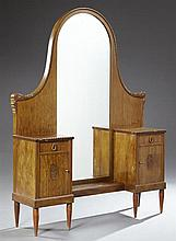 French Art Deco Carved Mahogany Dropwell Vanity, early 20th c., the arched mirror over an open shelf flanked by two drawers and two...