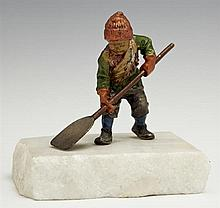 Austrian Cold Painted Bronze Figure, 20th c., of a boy shoveling snow, on a white marble base, H.- 4 in., W.- 4 in., D.- 3 1/2 in.
