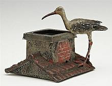 Patinated Spelter Figural Match Striker, late 19th c., in the form of a stork on a roof top, with original paint, H.- 2 3/4 in., W.-...