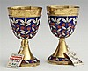Pair of Russian Gilt Silver and Enamel Footed Vodka Cups, 20th c., the lips with delicate rope banding above enameled fruiting limbs...