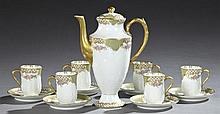 Thirteen Piece Limoges Porcelain Chocolate Set, c. 1900, by GOA (Haviland), consisting of a chocolate pot, six cups, and six saucers...