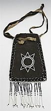 Native American Beaded Leather Tobacco Pouch, 20th c., with a drawstring closure, H.- 11 in., W.- 5 1/4 in.