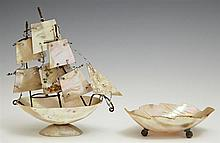 Two Diminutive Pieces of Mother of Pearl, early 20th c., consisting of a souvenir ship and a leaf form bowl, Ship- H.- 5 3/8 in., W....