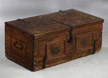 Early American Iron Bound Carved Pine Blanket Chest, early 19th c., the rectangular top with iron strap hinges, opening to an interi...