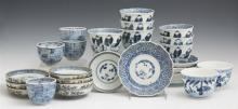Group of Twenty-Five Pieces of Oriental Blue and White Porcelain, 20th c., consisting of 4 small scalloped bowls; 7 figural teacups...