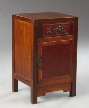 Chinese Carved Elm Nightstand, early 20th c., with a frieze drawer over a cupboard door with figural decoration, on square legs, H.-...