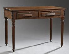 American Arts and Crafts Period Iron Bound Carved Oak Writing Table, c. 1900, the rectangular top over two frieze drawers, on ring t...