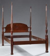 American Classical Carved Mahogany Four Post Bed, mid 20th c., the urn finials on tapered twist turned posts joining an arched headb...