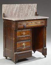 American Eastlake Carved Walnut Marble Top Washstand, late 19th c., the highly figured Tennessee Brown marble splash and top over a...