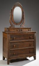 American Victorian Carved Mahogany Dresser, late 19th c., the oval mirror with a pierced crown, over two glove boxes, on a base with...