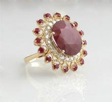 Lady's 14K Yellow Gold Dinner Ring, with an oval 13.8 carat ruby, atop a border of round diamonds, and an outer pierced border mount..