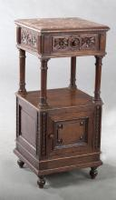 French Henri II Style Carved Oak Marble Top Nightstand, 19th c., the inset highly figured rouge marble over a frieze drawer flanked...