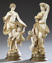 Pair of Austrian Turn Wien Polychromed Porcelain Figures, early 20th c., by Ernst Wahliss, depicting classical females with putti, o...