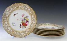 Set of Seven Chamberlain Worcester Dinner Plates, early 20th c., each with a scalloped edge and gilt decorated border, the central f...