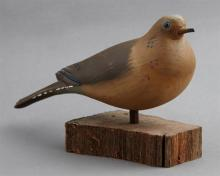 Carved and Polychromed Wood Dove Decoy, 20th c., by Will E. Kirkpatrick, signed, now on a wooden base, H.- 5 1/8 in., W.- 9 in., D.-...