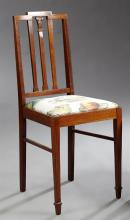 English Inlaid Mahogany Bedroom Chair, c. 1900, the stepped crest rail over three vertical splats, to a slip seat, on tapered square...