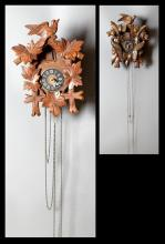 Two German Cuckoo Clocks, 20th c., with weights, Larger- H.- 16 1/2 in., W.- 12 1/4 in., D.- 6 in.