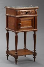 French Louis Philippe Style Carved Oak Marble Top Nightstand, late 19th c., the inset highly figured black marble over a frieze draw...