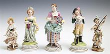 Group of Five German Painted Porcelain Figures, 19th c. and early 20th c., consisting of a woman with a floral wreath, a pair of fig...
