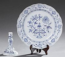 Two Pieces of Meissen Porcelain, one a blue and white candlestick with relief decoration; the second a large blue onion charger with...