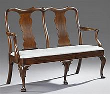 Carved Mahogany Queen Anne Style Double Chairback Settee, 20th c., the scrolled arched backs with vasiform splats, over a slip seat...