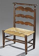 Unusual Large French Provincial Prie Dieu, 19th c., the shaped ladderback over a rush seat, on cylindrical legs joined by cylindrica...