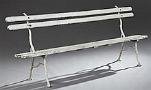 Cast Iron Slatted Garden Bench, c. 1880, on naturalistic supports, H.- 32 3/4 in., W.- 84 1/2 in., D.- 18 in.