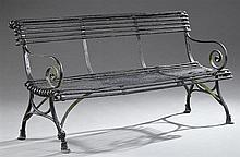 English Wrought Iron Garden Bench, early 20th c., with iron bar back and seat and scrolled arms, on trestle legs on hoof feet, H.- 3...