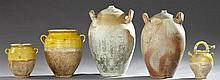 Five Pieces of French Provincial Glazed Earthenware, 19th c., consisting of two oil jars with integral ring handles, 2 confit jars a...